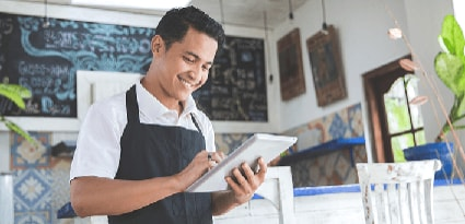 Man in a restaurant using a tablet